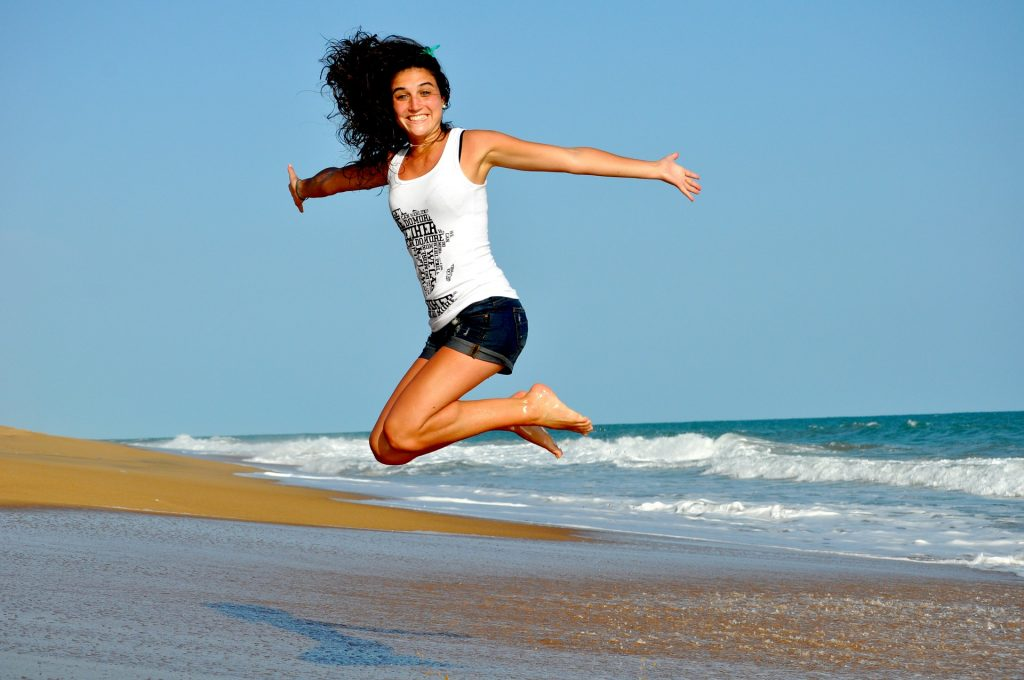 jumping woman at beach Ten of the Best Things to Boost Immune System Health