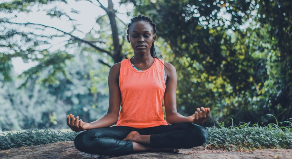 woman meditating to improve immune system health