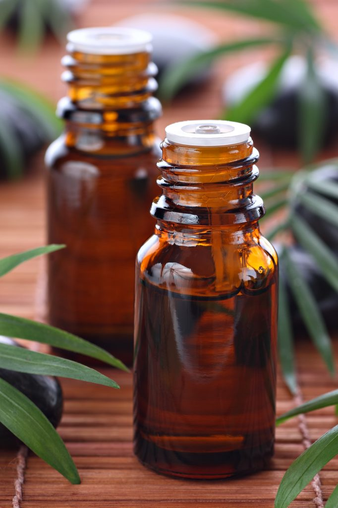 diy antiviral essential oil blend in brown bottles